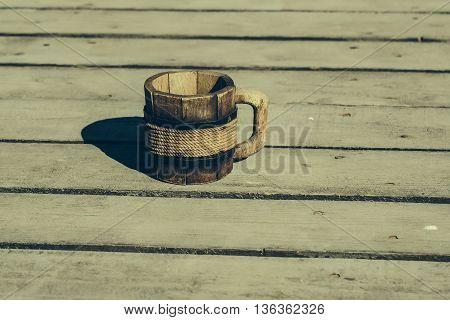 Wooden Mug On The Floor