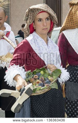 QUARTU S.E., ITALY - September 15, 2013: Wine Festival in honor of the celebration of St. Helena - Sardinia - portrait of a beautiful girl in traditional Sardinian costume