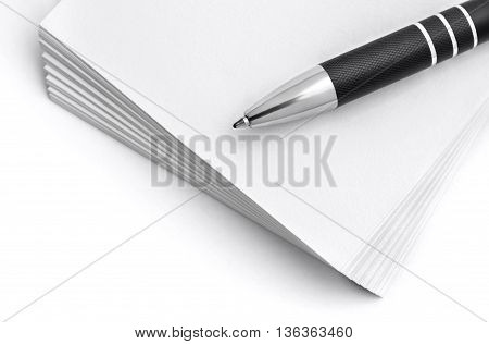 Selective focus image of pen on stack of paper