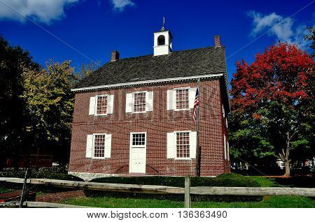 York Pennsylvania - October 16 2015: Restored 1754 Georgian style Colonial Courthouse with rooftop cupola and wooden stocks