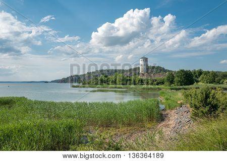 The bay of Slatbaken and Stegeborg Castle n Stegeborg during midsummer in Sweden. Stegeborg is a historic medieval royal castle.