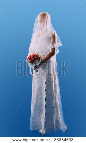 beautiful bride with blond hair on a blue background