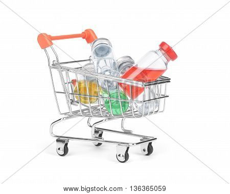 pill bottle in shopping cart trolley  closeup, bargains, remedy,