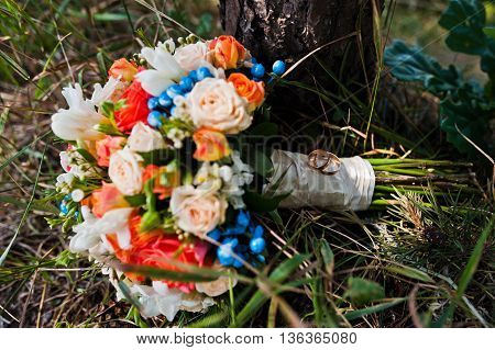 Wedding Bouquet With Rings At Pine Forest