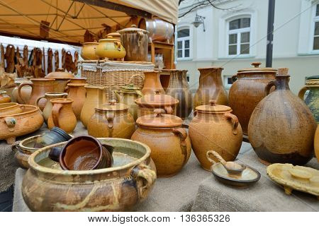 VILNIUS, LITHUANIA - MARCH 7: Typical lithuanian clay pots in annual traditional crafts fair - Kaziuko fair on Mar 7, 2014 in Vilnius, Lithuania