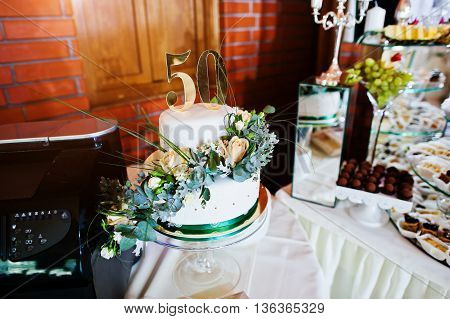 Cake anniversary in 50 at table at wedding