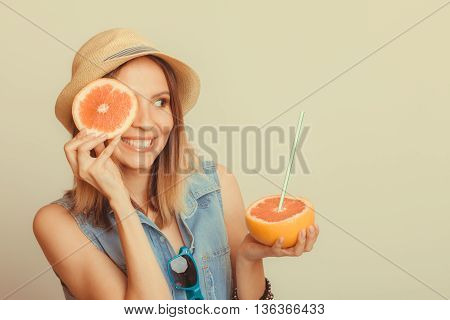 Woman Covering Her Eye With Grapefruit. Fun Summer