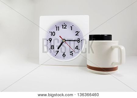clock with two coffee cup on isolated backgound
