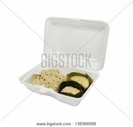 Rice with egg custard and white foam box.