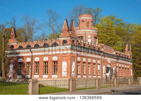 The old red brick building with towers in the Gothic Revival style in Tsarskoye Selo (Pushkin), St. Petersburg