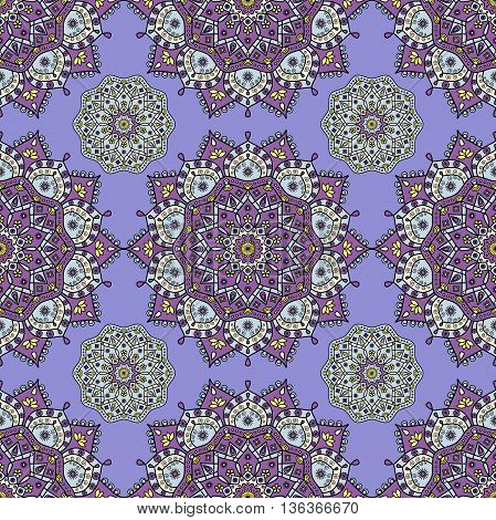 Seamless floral mandala pattern in purple, pale aqua blue & yellow on periwinkle blue background. Decorative vintage pattern for paper & textile prints of sari & sarong style ethnic garment layouts.