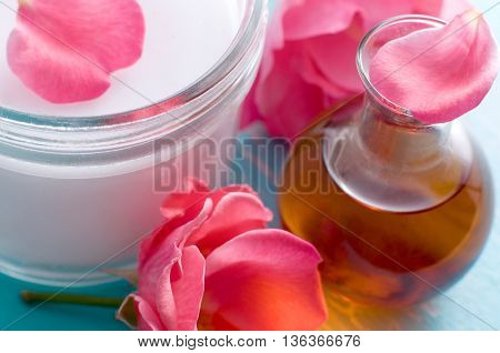 Massage oil and creme jar with pink roses