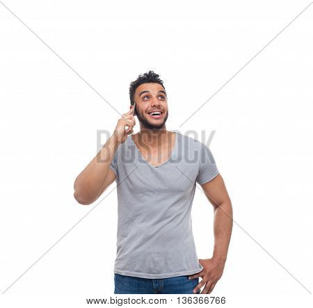 Casual Man Cell Smart Phone Call Look Up To Copy Space Happy Smile Young Handsome Guy Wear Shirt Jeans Isolated White Background