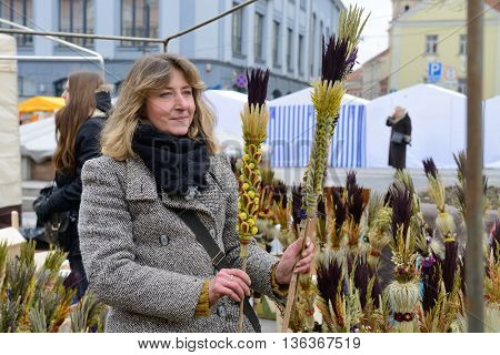 VILNIUS, LITHUANIA - MARCH 7: Unidentified people trade traditional palm bouquets in annual traditional crafts fair - Kaziuko fair on Mar 7, 2014 in Vilnius, Lithuania