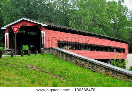 Chadds Ford Pennsylvania - June 2 2015: 19th century Smith Covered Bridge over the Brandywine Creek just across the Delaware border *