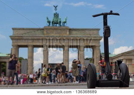 segway and tourists at brandenburg gate Berlin