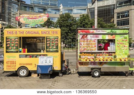 New York, USA - June 18, 2016: Hot dog and smoothie food trucks on Columbus Circle in New York City