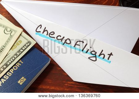 Paper plane with words cheap flight. Traveling concept.