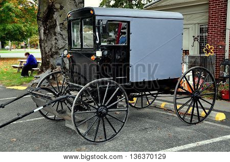 Bird-in-Hand Pennsylvania - October 14 2015: Classic Amish buggy with enclosed cab parked at the Bird-in-Hand Farmer's Market