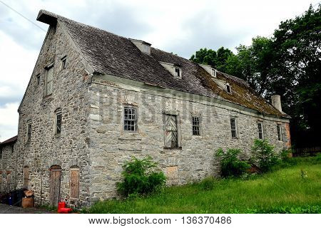 Lititz Pennsylvania - JUne 7 2015: Late 18th century old stone mill with shingled roof and small dormers on Market Street