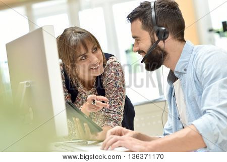 Telemarketing people working together in office