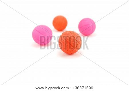 four ball basquetball reds and pinks isolated white background