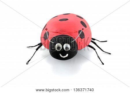 ladybug toy happy of wood isolated white background