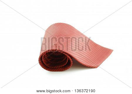 red tie rolled up isolated white background