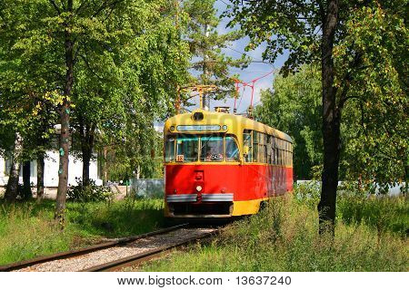 An old tram in bushes