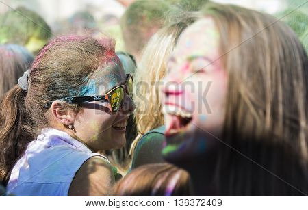 Lviv Ukraine - August 30 2015: Girl with glases have fun during the festival of color in a city park in Lviv.