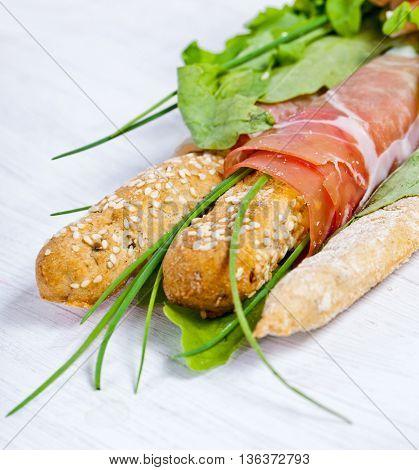 Parma ham prosciutto with grissini bread sticks
