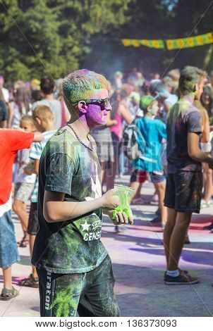 Lviv Ukraine - August 30 2015: Man with glases have fun during the festival of color in a city park in Lviv.
