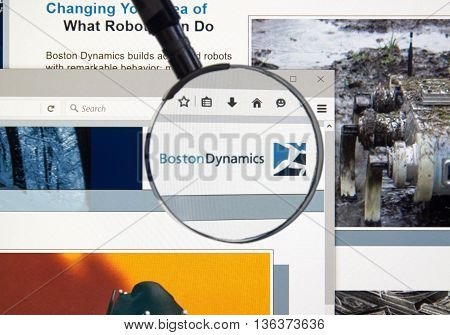 MONTREAL CANADA - JUNE 24 2016 : Boston Dynamics web page under magnifying glass. Boston Dynamics is the leading provider of human simulation software tools and solutions.