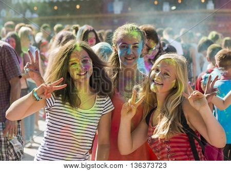 Lviv Ukraine - August 30 2015: Girls have fun during the festival of color in a city park in Lviv.