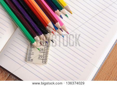 Crayons a ruler and Notepad closeup. School supplies