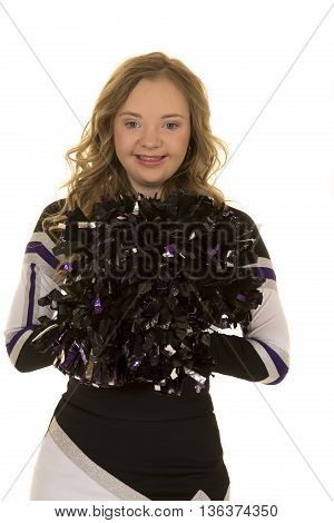a cheerleader who has down syndrome with a big smile on her face.