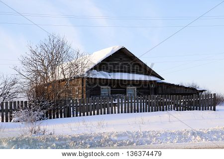 House In A Village In A Winter Day