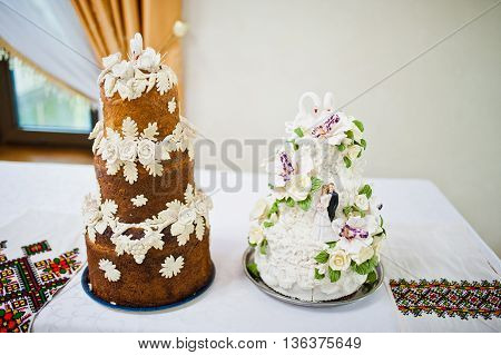 Two wedding cakes and loaf at wedding