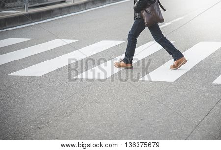Close up Man walking on crosswalk in Japan