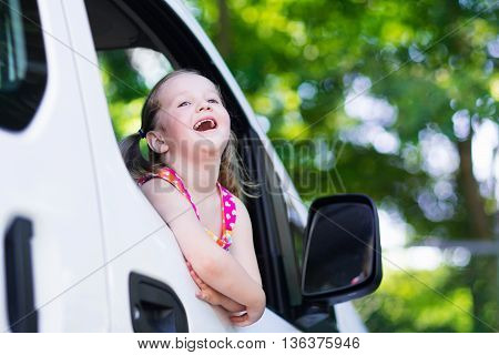 Little Girl Sitting In White Car