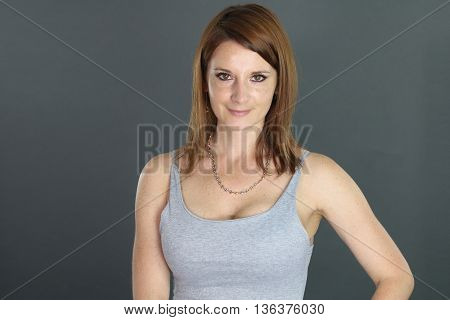 portrait of a beautiful woman of thirty years over a gray background