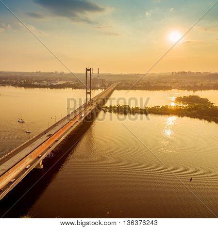 Beautiful scenery of the Southern bridge aerial view at sunset. The bridge across the Dnieper River. Kiev. Ukrain. 4k.