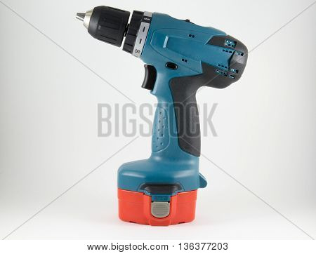 Cordless screwdriver on a white background .