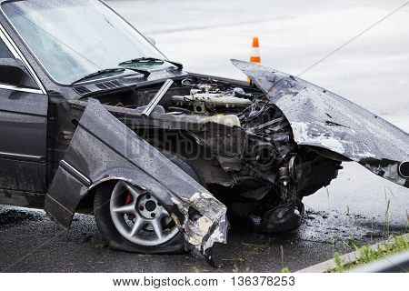 the broken car after accident on a road