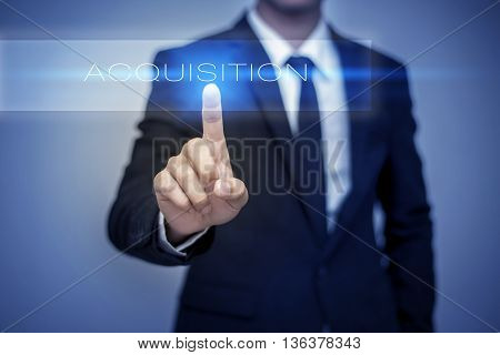 Businessman hand touching ACQUISITION button on virtual screen