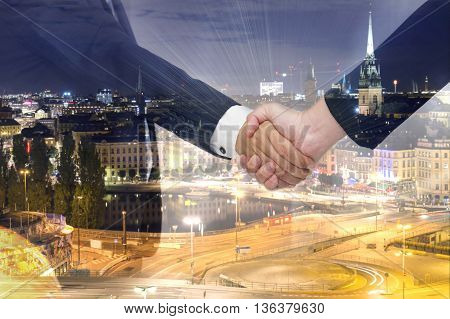 Teamwork For Success Of The Business In The Future. Double Exposure Of Handshake.
