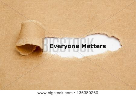 The text Everyone Matters appearing behind ripped brown paper.