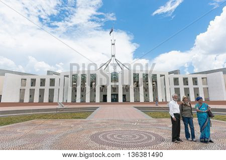 Canberra, Australia-January 23, 2011; Three Asian tourists pose for photo outside Australian Parliament House in Canberra.
