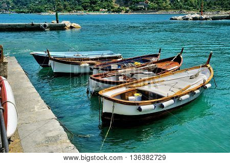 Fishing boats on blue water in Cinque Terre, Ligure, Italy