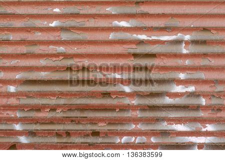 old wavy texture of corrugated iron for an abstract background or for wallpaper of rusty red color